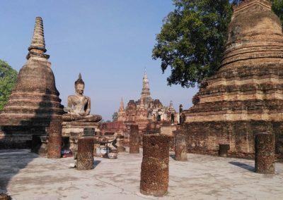 sukhothai - historical park - buddha with pagoda panorama